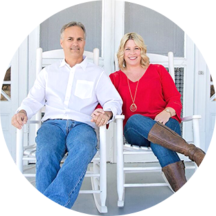 Pat and Michelle Jones sitting in white rocking chairs